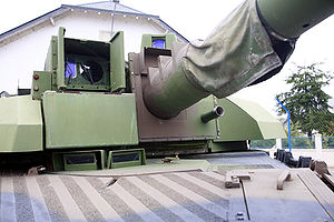 AMX Leclerc - Closeup of the front of the Leclerc's turret; the 12.7mm coaxial machine gun can be seen below and to the side of the 120mm main gun