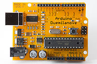 Arduino Duemilanove, an early production example in orange