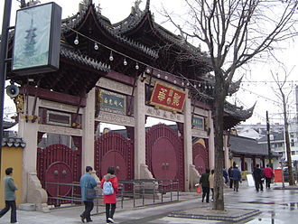 Longhua Temple - Newly constructed front gate of Longhua. The site of the original gates, further in front, is now marked by two standing pillars and a set of original stone lions.