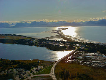 Homer, showing (from bottom to top) the edge of downtown, its airport and the Spit Looking into the sun from over downtown onto the Homer Spit..jpg