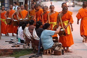 Luang Prabang Province - The monks' alms procession at dawn includes receiving sticky rice.