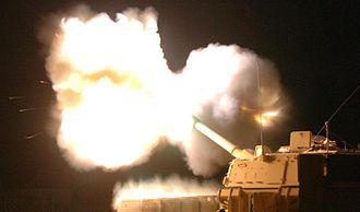 "M109 howitzer - M109A6 ""Paladin"" firing at night"