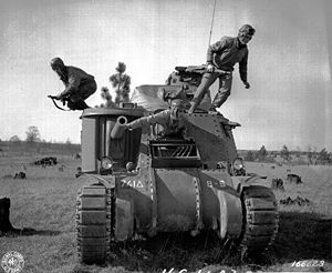 741st Tank Battalion (United States) - Crew from Company B, 741st Tank Battalion abandons its M3 Grant tank during the Third Army Louisiana Maneuvers at Fort Polk, Louisiana, 12 February 1943. These tanks were replaced by M4 Shermans before the battalion entered combat in France. (U.S. Army Signal Corps)