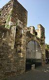 foto van Resten van de 1e middeleeuwse stadsmuur nabij Lang Grachtje.