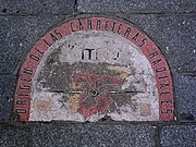 The kilómetro cero (kilometer zero) on the pavement in front of the House of the Post Office.