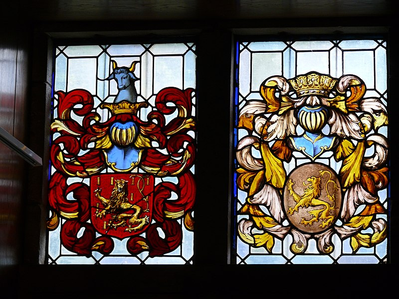 Stained glass window with coat of arms above a window in Renesse castle in Oostmalle, Belgium.