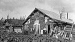 Man, woman and child in front of McGrath Post Office, McGrath, Alaska, September 1914 (AL+CA 3904).jpg