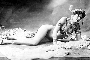 Striptease - Mata Hari. The most celebrated segment of her stage act was the progressive shedding of her clothing until she wore just a jeweled bra and some ornaments over her arms and head