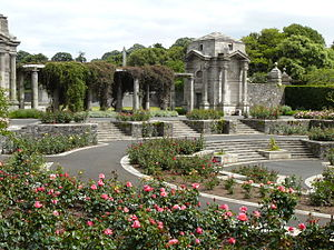 Irish National War Memorial Gardens - Circular Sunken Rose Garden  in side view, showing one of four granite Bookrooms
