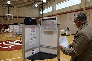Michael Georg Link examines a voting booth in Washington, DC, 3 Nov. 2020 (50564571952).jpg
