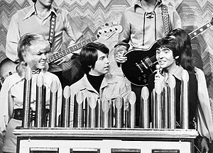Mike Curb - Curb (center) with members of the Mike Curb Congregation and Davy Jones on a television special in 1972.
