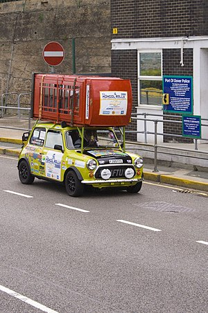 Mini with red telephone box embarking on the M...