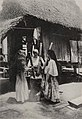 Mother and daughters hulling rice, page 73, Island of Guam (1917) (cropped).jpg