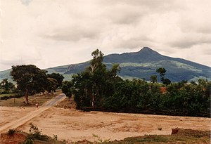 Nat (spirit) - Mount Popa and Taung Kalat to left of picture seen from a distance across a dry riverbed