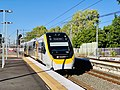NGR729 train approaching Corinda railway station, Queensland.jpg