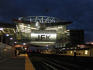Howard Beach–JFK Airport (IND Rockaway Line) - A view of the subway platforms and mezzanine at night.