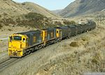 "Two ""Bumble bee"" DX class locomotives of New Zealand Railways pulls a coal train on the Midland Line in 2006"
