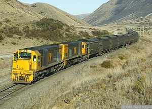 "Midland Line, New Zealand - Two DX class locomotives in Tranz Rail ""Bumble-bee"" livery hauling a 1,800 tonne coal train on the Midland line."