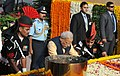 Narendra Modi laying wreath at Amar Jawan Jyoti on the occasion of the Centenary commemoration of World War –I, in New Delhi on March 10, 2015. The Chief of the Air Staff, Air Chief Marshal Arup Raha is also seen.jpg