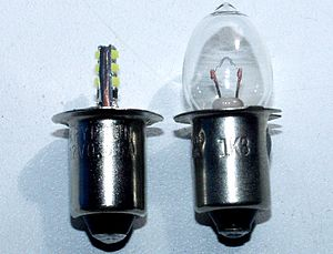 LED Flashlight replacement bulb (left), with t...