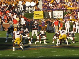 Cam Newton - Newton receiving a snap in 2010 against the LSU Tigers