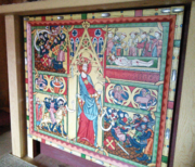 An altar frontal showing St Olav with axe in the middle and four scenes, each with roughly a quarter of the field, depicting his life and sainthood.