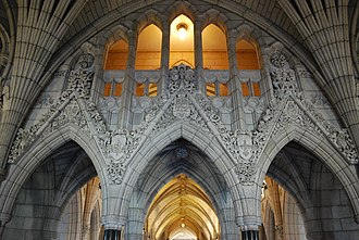 Centre Block - Arcaded arches in the west bay of Confederation Hall, the tympanums displaying the escutcheon of, left to right, Ontario, Canada, and Quebec