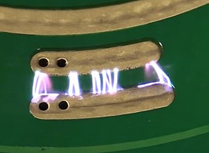 Spark gap - The switch contacts on a multimeter acting as a PCB spark gap.