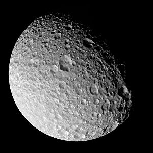 Mimas (moon) - Cassini view of Mimas's trailing hemisphere, showing craters up to 6 km deep and 1-km-deep chasmata (grooves). The large crater near center is Morgan; Arthur is close to the lower right limb. Pelion Chasma is faintly visible as a horizontal trough left of Arthur and below Morgan.