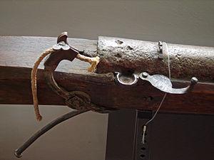 Arquebus - A serpentine matchlock mechanism.