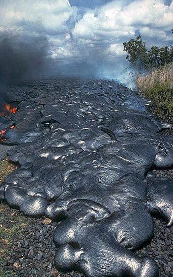 Toes of a pahoehoe advance across a road in Kalapana on the east rift zone of Kilauea Volcano in Hawaii, United States PahoehoeLava.jpg