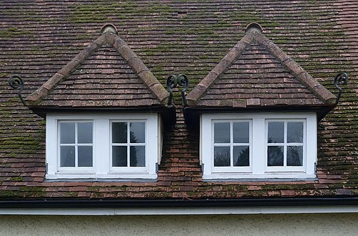 Pair of hip roof dormer windows on the Howard Memorial Hall, Letchworth Paired dormer windows, Letchworth (geograph 4237604).jpg