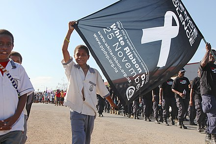 Papua New Guinean children, men and women show their support for putting an end to violence against women during a White Ribbon Day march Papua New Guinean children, men and women show their support for putting an end to violence against women during a White Ribbon Day march (21614943268).jpg
