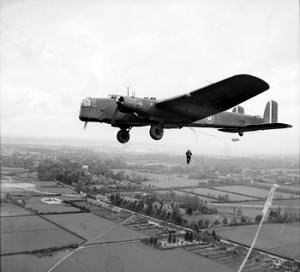 9th (Eastern and Home Counties) Parachute Battalion - Parachute troops jumping from a Whitley bomber near Windsor England.