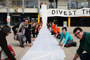 Fossil fuel divestment - In 2015, ANU students present a giant petition to the ANU Council