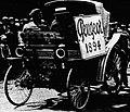 Peugeot fiacre découvert du Paris-Rouen 1894, au défilé Historique du Touring Club de France en 1919 dans le bois de Marly.jpg