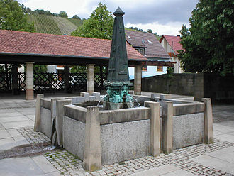 Pfaffenhofen, Baden-Württemberg - fountain at the Kelterplatz in front of the parish church