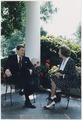 Photograph of President Reagan and Prime Minister Thatcher talking on the patio outside of the Oval Office - NARA - 198587.tif