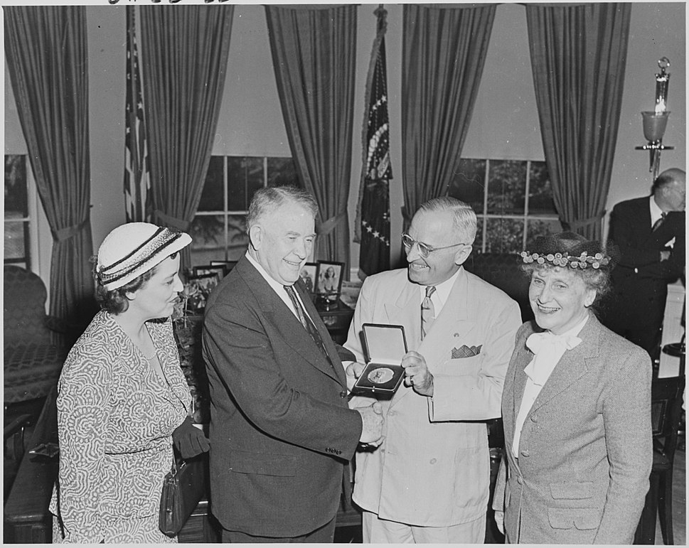 Photograph of President Truman in the Oval Office, shaking hands with Vice President Alben Barkley as he presents him... - NARA - 200220