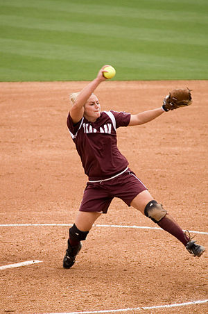 "Softball - Fastpitch pitcher Megan Gibson pitching the ball in the ""windmill"" motion"