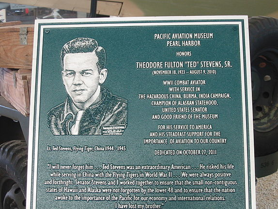 The Pacific Aviation Museum Pearl Harbor displays a collection of Stevens' wartime photos and souvenirs in connection to his flying supplies to the Flying Tigers. Plaque honoring Ted Stevens' wartime service.jpg