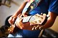 Playing guitar (7914618736).jpg