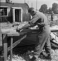 Post War Planning and Reconstruction in Britain- Grenadier Guardsmen Build Emergency Housing in Windsor D25710.jpg