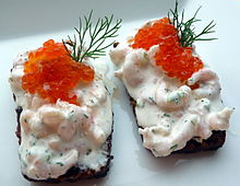 ภาพอาหารจากไข่ปลา Prawns skagen topped with cold-smoked salmon roe, on bread
