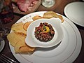 Prime steak tartare, sauce verte, egg yolk, gaufrette potatoes.jpg