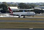 Qantas 767-300 landing (5686610479).jpg