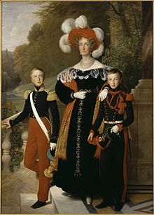 Henri (left) with his brother Antoine and his mother Queen Marie Amélie. (Source: Wikimedia)