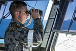 RAN sailor on the bridge of HMAS Canberra.jpg