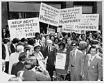 Rally in support of Hubert H. Humphrey for president, April 6, 1972. Placards focus on food costs. (5279065938).jpg