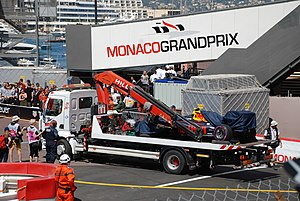 2016 Monaco Grand Prix - The wreckage of Max Verstappen's car is cleared off the track.
